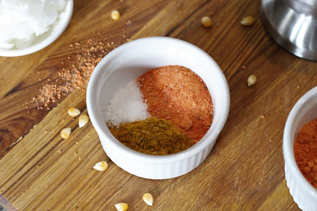 carrot powder, curry powder, and salt in a bowl