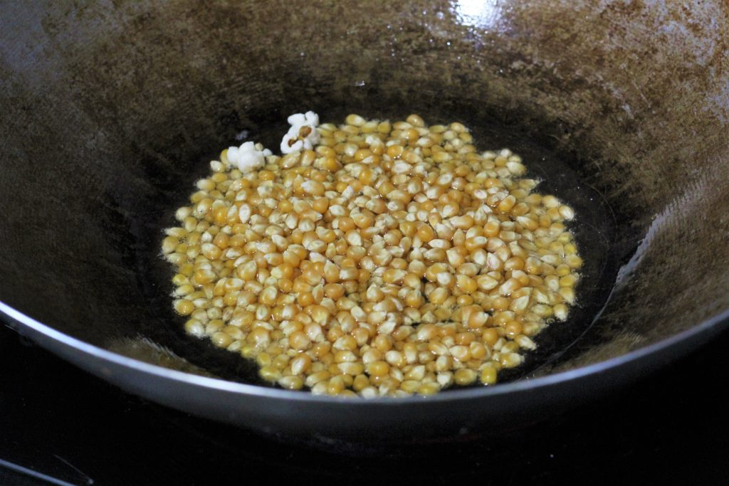remaining popcorn kernels added to the pan