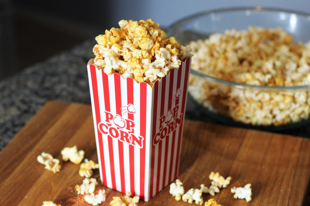 finished popcorn in a movie theater style popcorn container