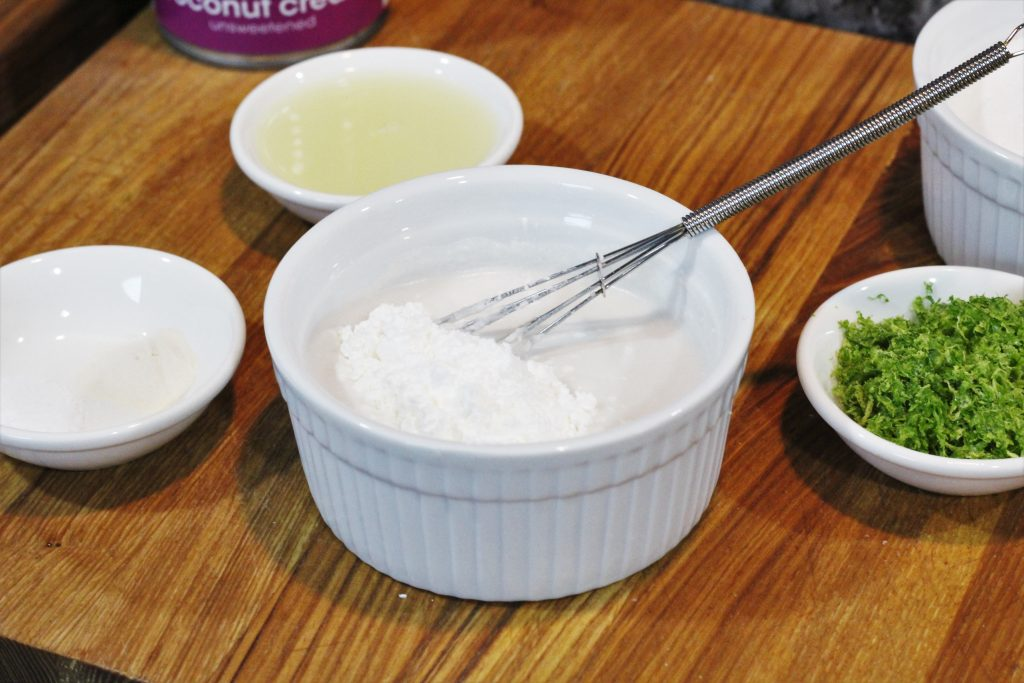 Coconut milk and cornstarch being mixed in a small bowl.