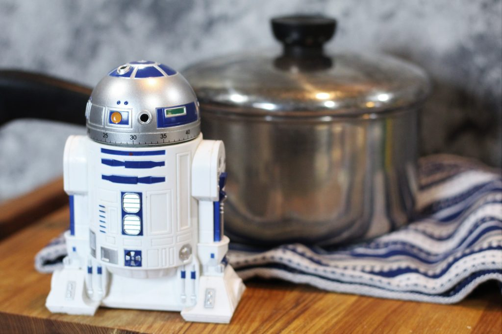 An R2-D2 kitchen timer set to 30 minutes with a covered saucepan in the background.